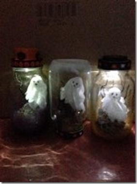 Ghosts in Jars in dark lighted